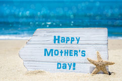 Mother`s daybackground with starfish on the sandy beach Royalty Free Stock Images