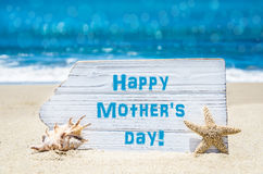 Mother`s daybbackground with seashell  and starfish on the sandy Royalty Free Stock Images