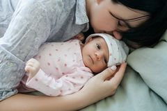 A mother`s daytime sleep with her newborn baby. Tired but happy. family values royalty free stock photos