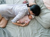 A mother`s daytime sleep with her newborn baby. Tired but happy. family values stock images