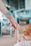Mother's hand holding the child's hand Royalty Free Stock Photos
