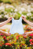 Mother's hands holding a baby's clothes Royalty Free Stock Photo