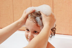 Mother's hands are washed the little boy's head Stock Photos