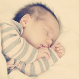 Mother's happiness little sleeping newborn baby Stock Photography