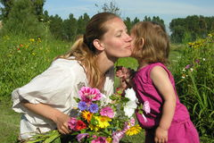 Mother's kiss Stock Photography