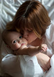 Mother's kiss Royalty Free Stock Images
