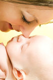 Mother's love. Cute baby 2 month with mother Royalty Free Stock Image