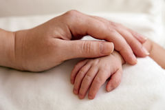 Mother's and newborn's hands Royalty Free Stock Photos