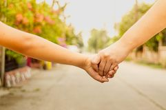 Mother and son hold hands, arms forward, concept. royalty free stock images
