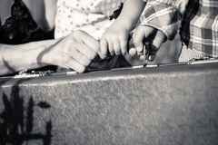 Mother's and two kids' hands holding a handle of Royalty Free Stock Image