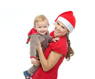 Mother in Santas hat playing with baby Royalty Free Stock Images