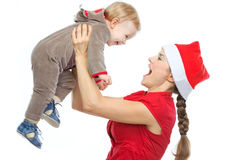 Mother in Santas hat playing with baby Royalty Free Stock Photos