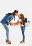 First day of School. Mother saying goodbye to her daughter on first day of school Stock Photos