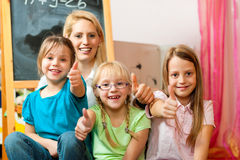 Mother with schoolchildren Stock Photography