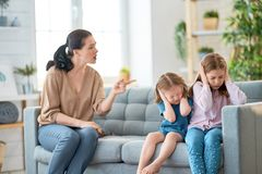 Mother is scolding children. Mother is scolding her children girls. family relationships royalty free stock image