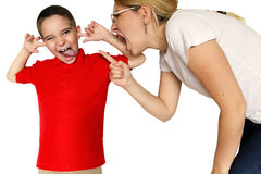 Mother scolding a disobedient son. Royalty Free Stock Photography