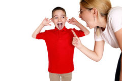 Mother scolding a disobedient son. Stock Images