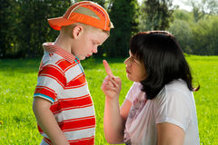 Mother scolding her son. With pointed finger in park Stock Photography