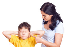 Mother scolding his son. With pointed finger stock photography