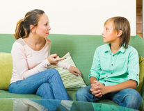 Mother scolding teenage son Royalty Free Stock Photography