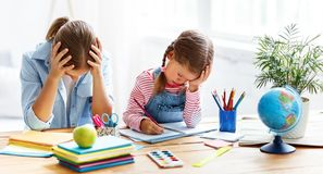 Mother scolds a child for poor schooling and homework Royalty Free Stock Photography