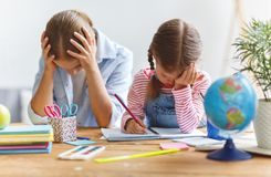 . mother scolds a child for poor schooling and homework Stock Image