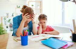 Mother scolds a child for poor schooling  and homework. At home stock images
