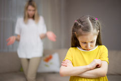 Mother scolds her daughter. Family relationships. The education of the child. Mother scolds her young daughter. Family relationships royalty free stock image