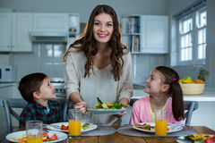 Mother serving breakfast to their children Stock Images