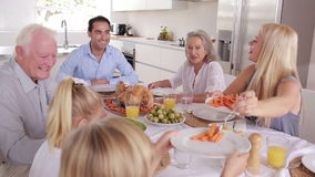 Mother serving carrots to son at family dinner Royalty Free Stock Images