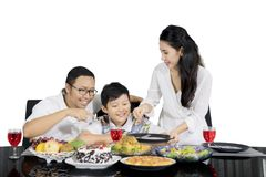 Mother serving foods before lunch together Royalty Free Stock Photo