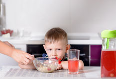 Mother serving her young son his lunch Stock Image