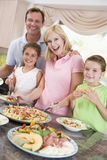 Mother Serving Up Dinner For Family stock images