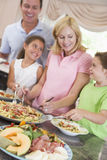 Mother Serving Up Dinner For Family royalty free stock images