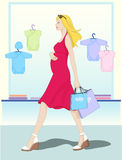 Mother shopping baby's clothes Stock Images