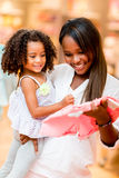 Mother shopping clothes for her daughter Stock Image