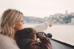 Mother showing away to son with binoculars looking, gazing, sear Royalty Free Stock Photos