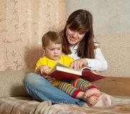 Mother showing book to her baby Royalty Free Stock Photos