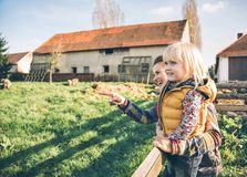 Mother showing child something on farm Royalty Free Stock Photography