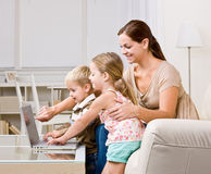 Mother showing children laptop Royalty Free Stock Photography