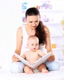 Mother showing images in a book Royalty Free Stock Photo