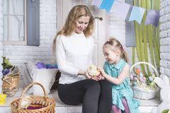 Mother shows daughter chick-foil stock images