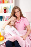 Mother with sick child Stock Photography
