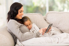 Mother sitting couch Royalty Free Stock Photography