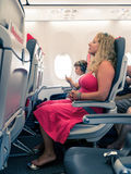 Mother sitting in a plane with young boy Royalty Free Stock Photos