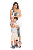 Mother and six year old son. Portrait of a mother and six year old son to his full length Royalty Free Stock Photography