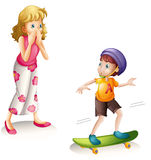 Mother and skateboarding son Stock Photography