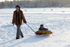 Mother sled her son Stock Images