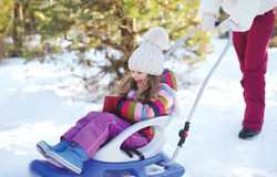 Mother sledding child in winter Royalty Free Stock Photography