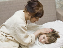 Mother and sleeping child Stock Photo